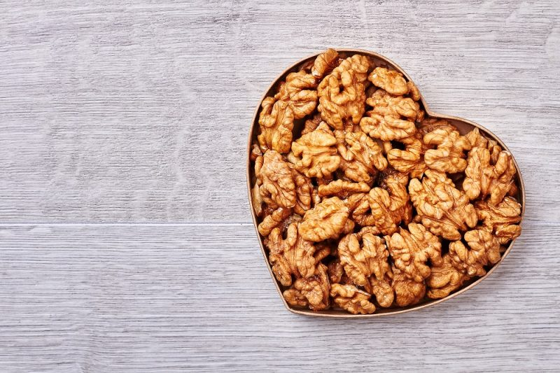 """Regular consumption of foods rich in omega-3s, including walnuts and fish, can reduce risk of death three years after suffering a heart attack."""