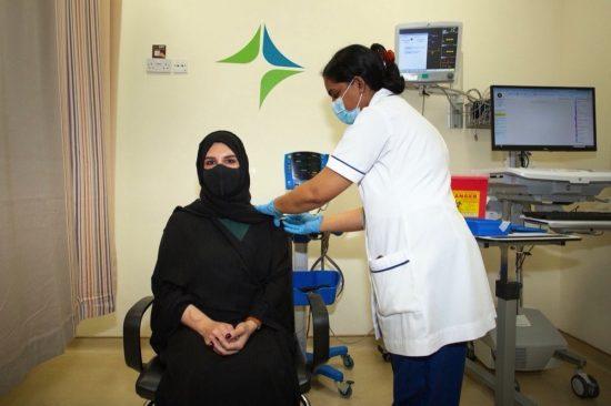 Hala Badri receives first dose of Pfizer-BioNTech vaccine