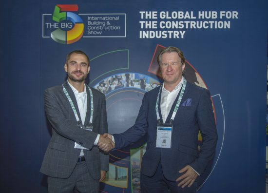 MYCRANE founder Andrei Geikalo, left, is pictured at The Big 5 trade show, Dubai with with new UAE and Oman franchise partner Kirill Vishensky